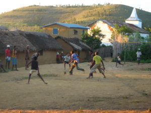 Boys playing soccer in a semi-rural Madagascar village.
