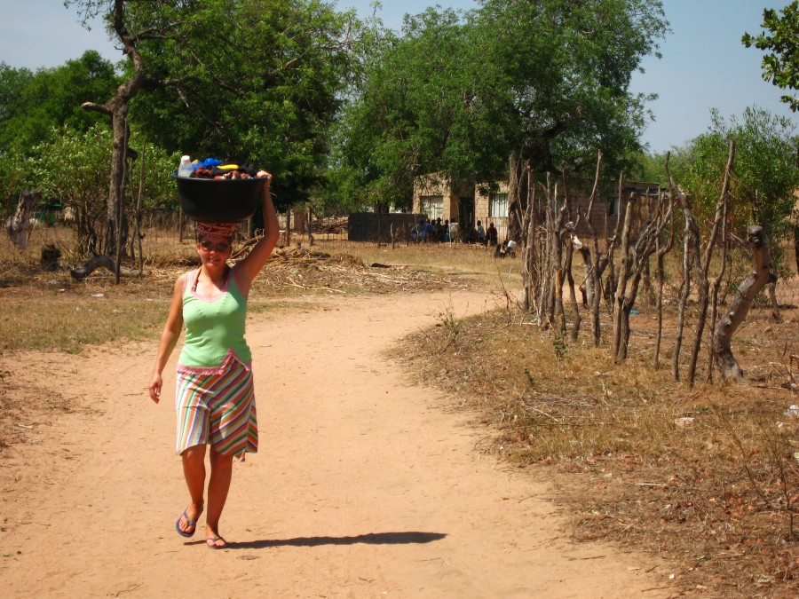 Lora carrying laundry to the river