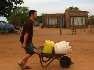 Adam pushing water in our wheelbarrow