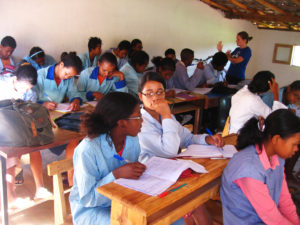 Lora teaching an English lesson in a classroom in Madagascar
