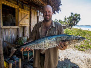 """One of our team members with a nice big """"ango"""", the sort of fish we often catch with a trolling lure on our boat trips to and from the Port."""