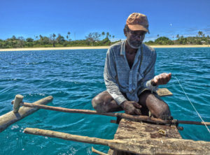 Fishing with Papan'mwana (the king of Nosy Mitsio) on his little canoe, out in front of our village.