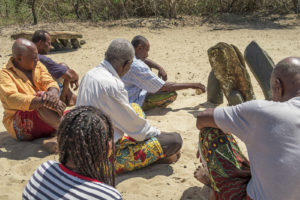 Many of the local village headmen offering a sacrifice at the sacred stones in our village.