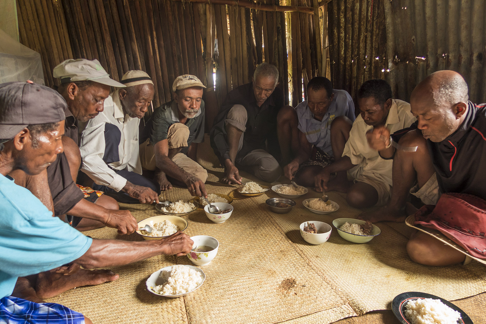 All of the headmen eating together at the recent funeral.