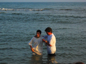 A baptism for a new believer, in the Mediterranean sea near Rome.
