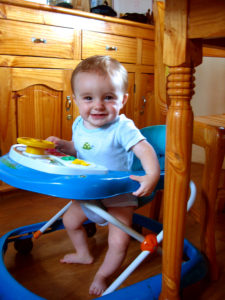 "Matimu is learning more every day. Now he can scoot around in his ""walker"", moving quickly to any part of the room he wants... we just have to watch our toes to make sure he doesn't run over them!"