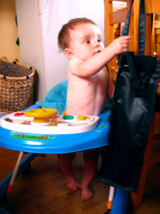 Matimu in his walker playing with our language teacher's purse.