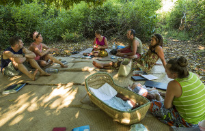 Our team meeting under a mango tree each week while waiting for our meeting hut to be rebuilt.