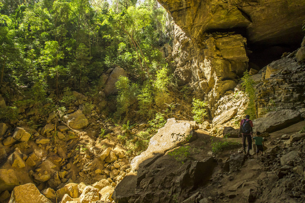Matimu hiking out of a large cave in the Ankarana national park. It's one of the caves where Antakarana people used to bury some of their ancestors.