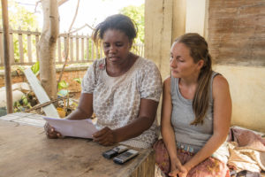 Our friend Nuckiline, helping Lora with Antakarana Bible story translation