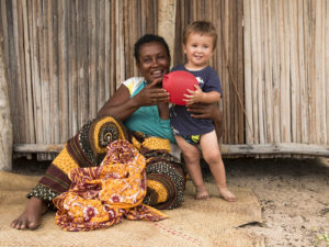 David playing with his birthday balloon with the headlady of our village, Mamani'Moana.