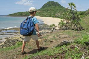 Matimu walking to a village north of us, Andavakabiby, to learn homeschool lessons there with our short-termer, Amelia.