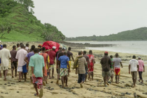 Walking along the beach with the guys carrying the body to the gravesite.