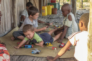 The kids in our village playing with Matimu and David on our porch.