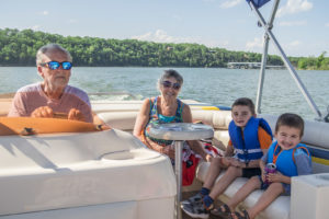 Matimu and David enjoying a nice boat ride on Table Rock Lake with their grandparents (Lora's parents).