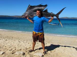Catching a sailfish near Nosy Mitsio
