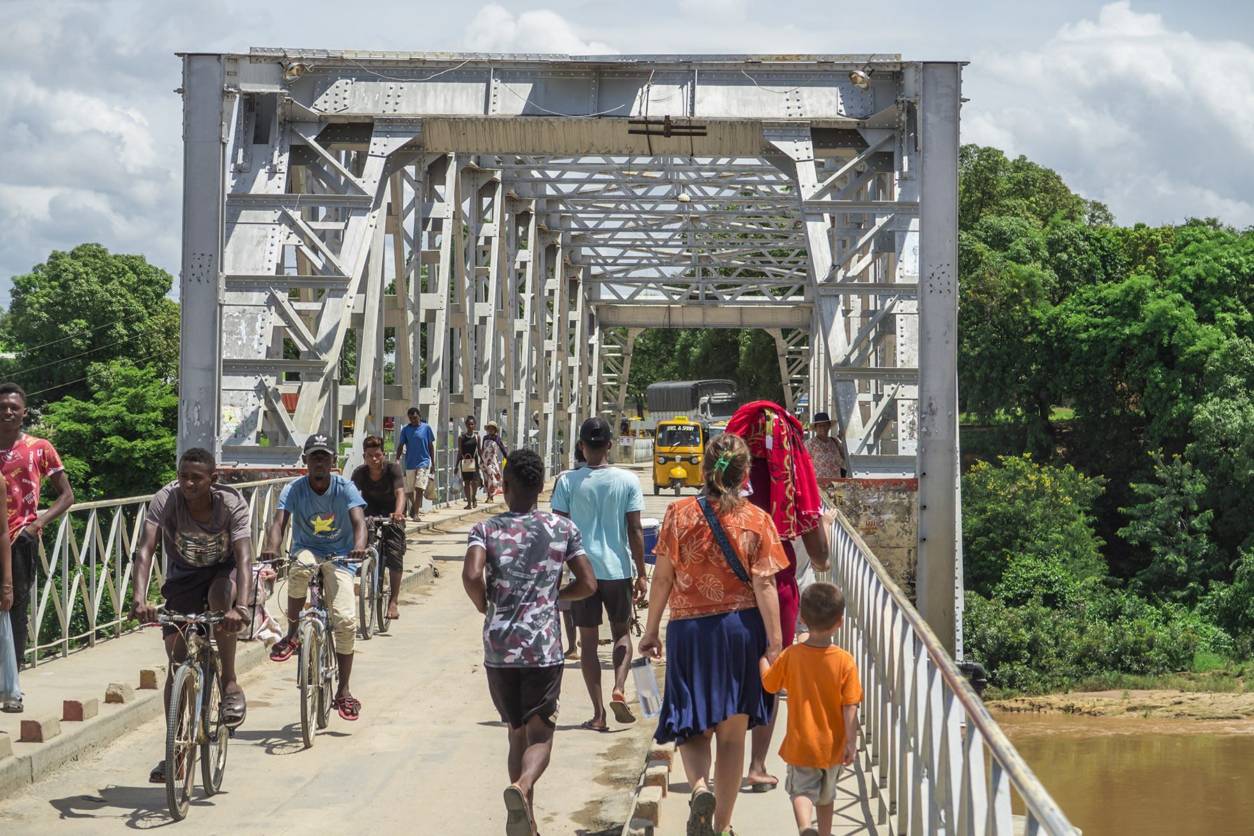 A busy road - the crossing of the Mahavavy river, entering into the central part of Ambilobe.  Lora is leading our boys back home after a local ministry outreach.