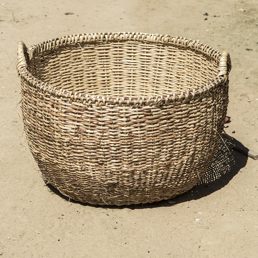 An empty wicker basket.  The same type of basket used here for transporting dried fish and other goods to the market.