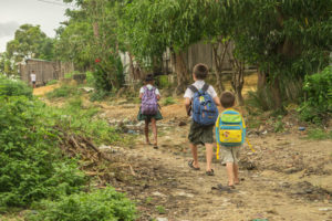 Matimu and David walking through our neighborhood to school (before the covid-19 restrictions closed all the schools).