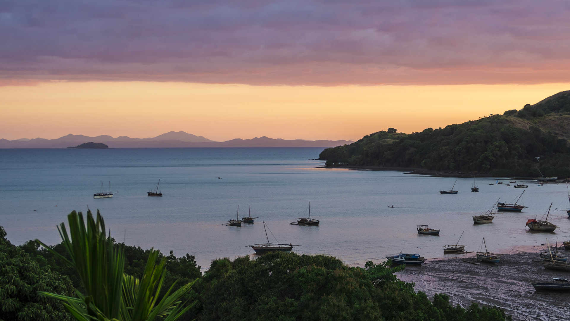 Sunset over a popular harbor of Nosy Be.
