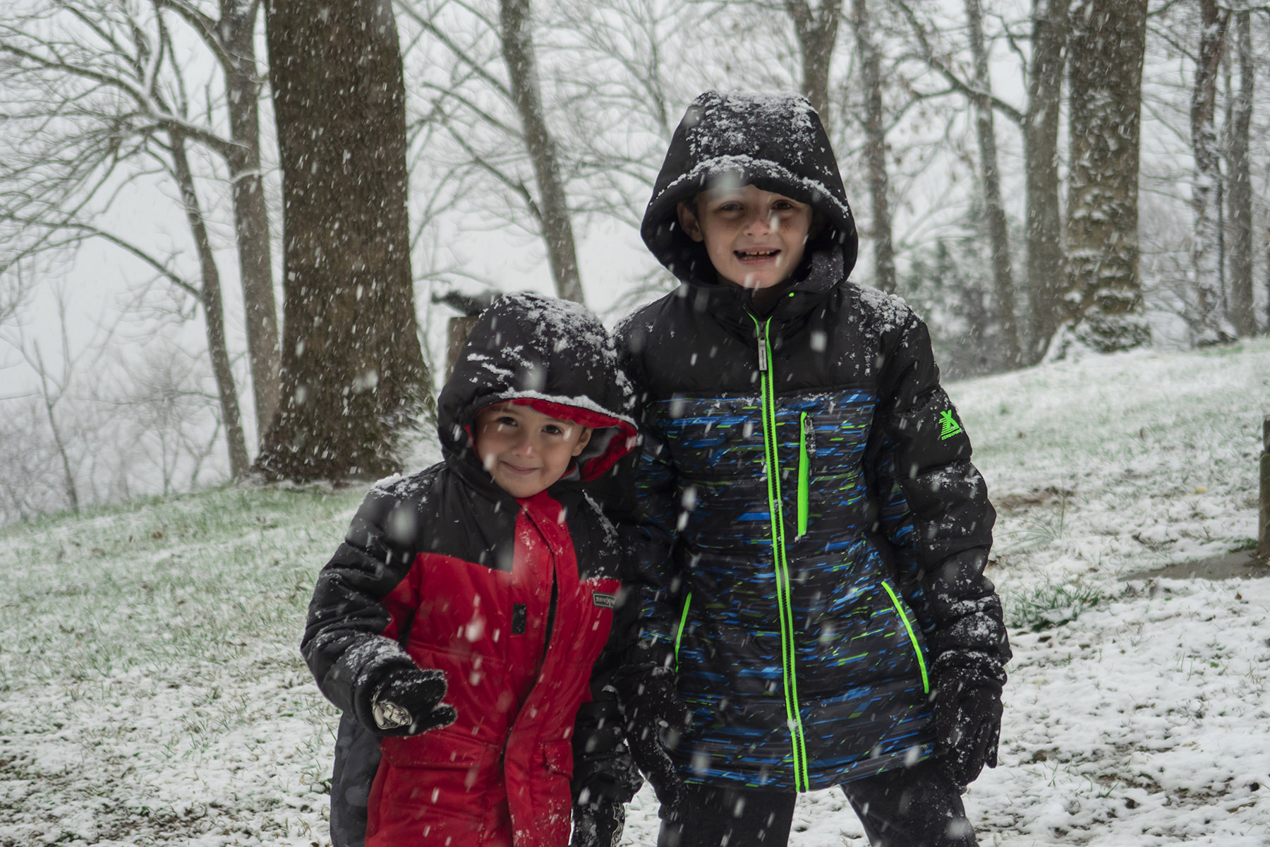 Matimu and David playing in the snow shortly after arriving back in the US.  It was David's first time to ever play in the snow!