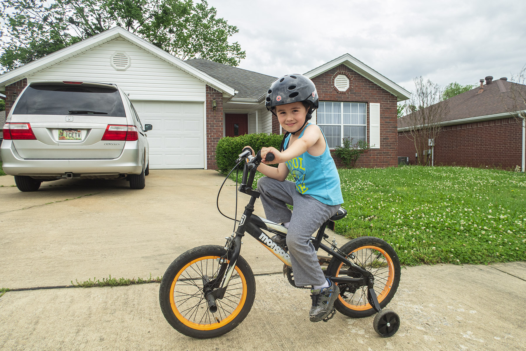 David learning to ride a bike at our house in Fayetteville